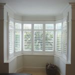 White Shutters In Round Bay Window