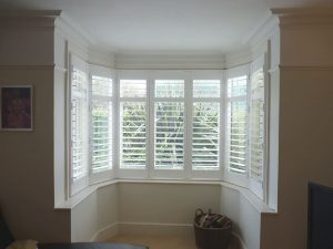 White Shutters In Round Bay Window