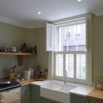 Tier On Tier White Window Shutters In Kitchen With Top Shutters Open