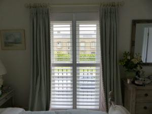 White Shutters On Bedroom Balcony Doors
