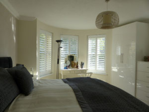Three Angled Shutters In Bedroom Windows