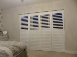 White Plantation Shutter Doors With Top Set Of Louvres Open