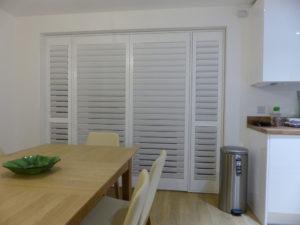 White Shutter Blinds On Kitchen Doors