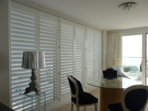 White Tracked Shutters On Patio Doors