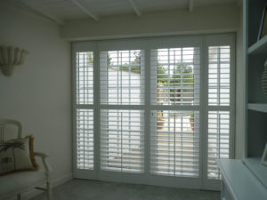 White Shutters Blinds On French Doors