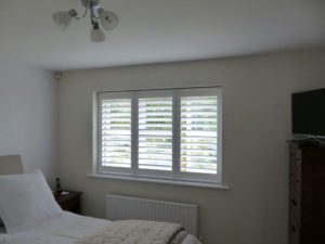 Bedroom Window With White Shutter Blinds