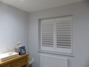 White Shutter Blind With TPost In Two Panel Window
