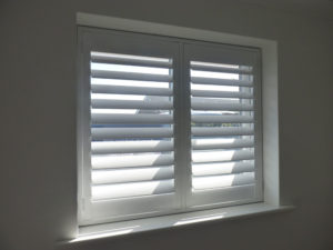 White Shutters In Small Two Panel Window