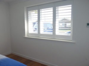 White Wooden Shutters With TPosts