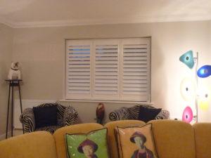White Shutter Blinds In Living Room Window