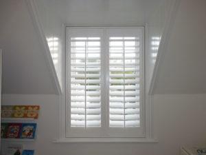 White Shutters In Tall Window