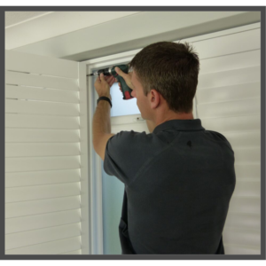 Sam from Chelmsford Shutters fitting shutters with drill